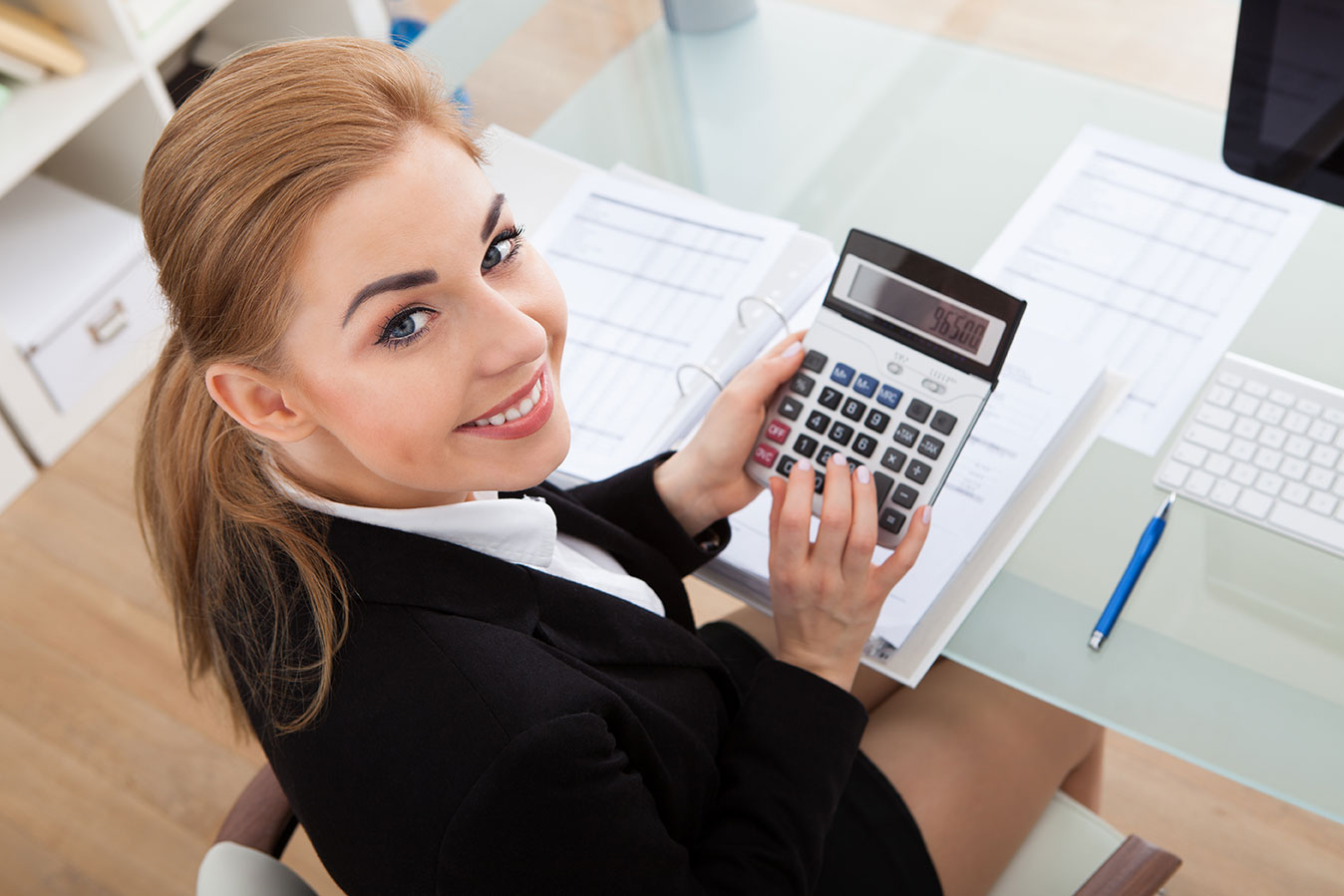 54e67c57ea3bd5c520847cd9_Young-Businesswoman-Working.jpg